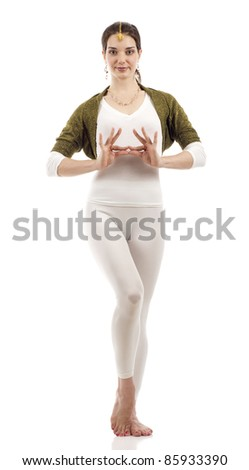 Full length of a beautiful smiling Bollywood dancer with hand gesture isolated over white background - stock photo