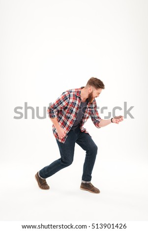 Full length of a casual bearded man in plaid shirt playing air guitar isolated on a white background