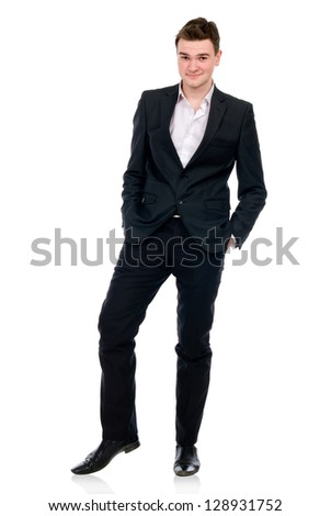 Full length of a cheerful business man standing with hands in pocket against white - stock photo