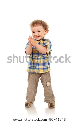 Full length of a cute boy smiling and looking a side - stock photo