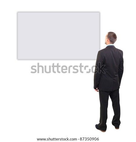 Full length of a handsome business man with hands folded against white background - stock photo