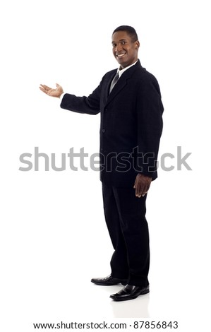 Full length of a happy black business man presenting and showing with copy space for your text isolated on white background - stock photo