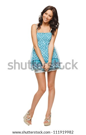 Full length of a happy young woman smiling against white background - stock photo