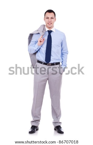 Full length of a relaxed young business man holding coat over shoulders isolated on white background - stock photo