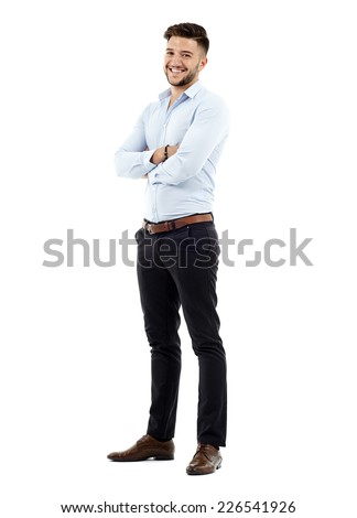 Full length of a young caucasian businessman with arms folded  - stock photo