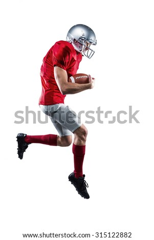 Full length of American football player holding ball while running against white background - stock photo