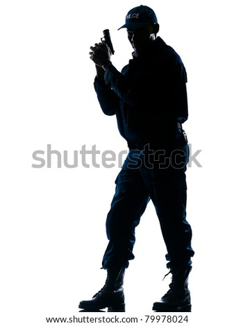 Full length of an alert afro American policeman standing with handgun on white isolated background - stock photo