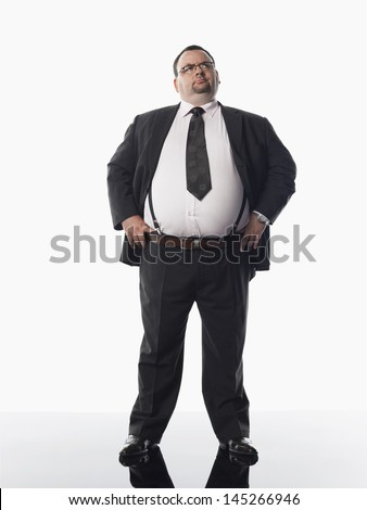 Full length of an overweight businessman standing against white background - stock photo