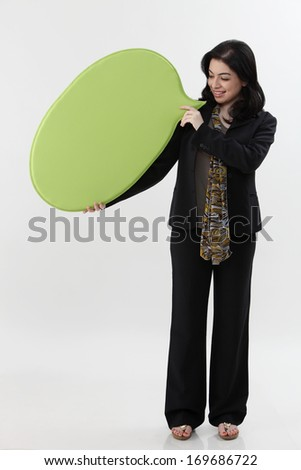 Full length of Asian Business woman holding a speech bubble
