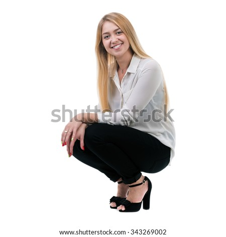 Full length of beautiful blond business woman sitting over isolated white background with copy space - stock photo