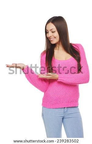 Full length of beautiful tanned woman in shorts showing holding on the palm blank copy space over white background