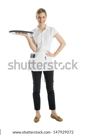 Full length of beautiful waitress with serving tray standing isolated against white background