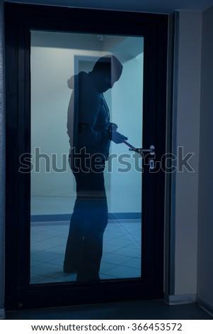 Full length of burglar using crowbar to open glass door at night & Burglary Door Stock Images Royalty-Free Images \u0026 Vectors ... Pezcame.Com