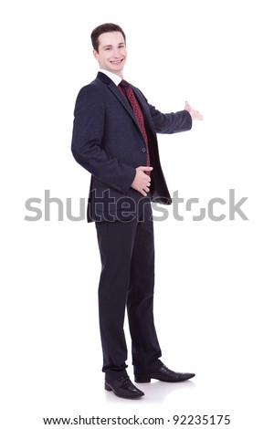 Full length of business man in black suit making presentation to copy space isolated on white background