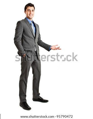 Full length of business man making presentation to copy space isolated on white - stock photo