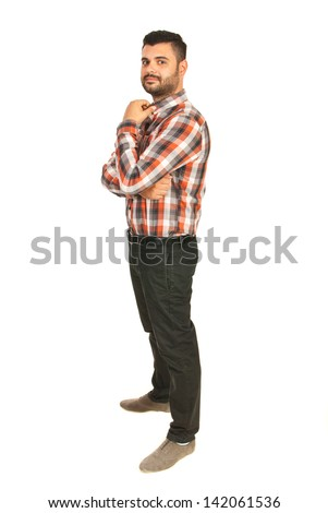 Full length of business mans tanding in profile and holkding hand to collar shirt isolatedon white background - stock photo