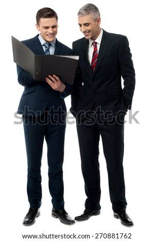 Full length of business people reviewing reports  - stock photo