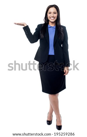 Full length of business woman presenting a copy space - stock photo