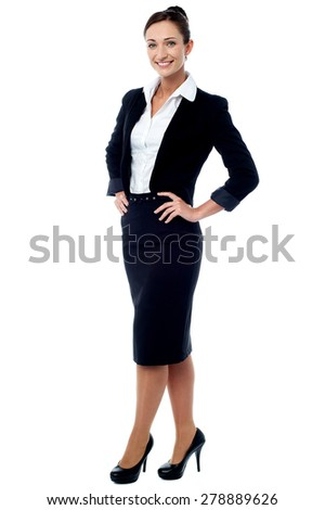 Full length of businesswoman posing casually - stock photo