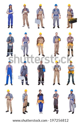 Full length of confident multiethnic engineers standing against white background