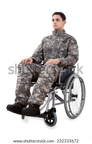 Full length of determined soldier sitting in wheelchair isolated over white background - stock photo