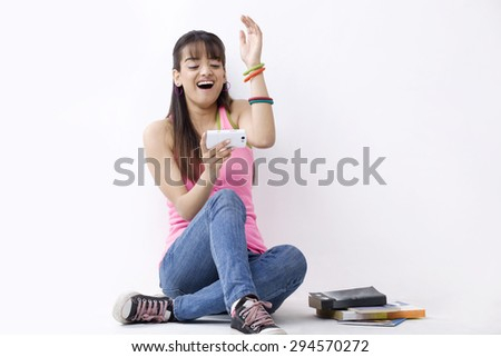 Full length of excited female college student reading text message - stock photo