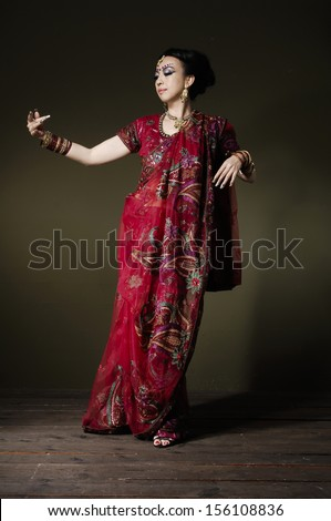 Full length of fashion portrait of beautiful female wearing traditional costume, posing