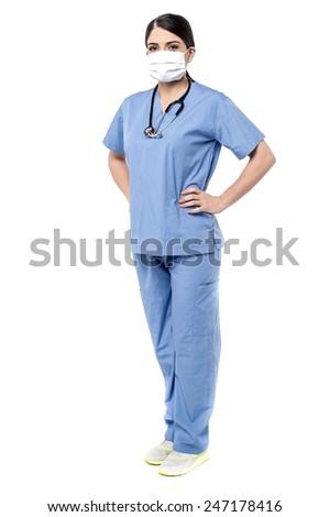 Full length of female surgeon posing confidently - stock photo