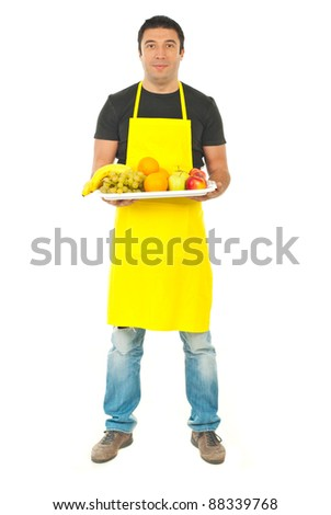 Full length of greengrocer holding plateau with fresh different fruits isolated on white background
