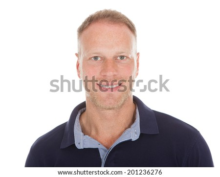 Full length of handsome mid adult man in casuals over white background