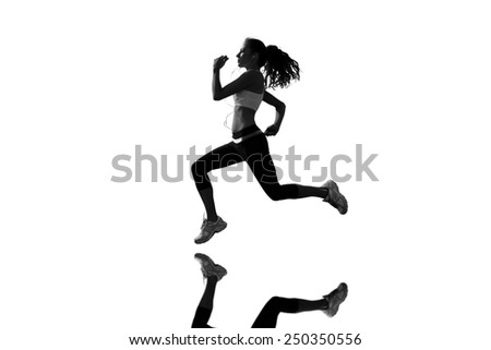 Full length of healthy woman jogging against mirror - stock photo