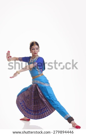 Full length of Indian female performing classical dance over white background - stock photo