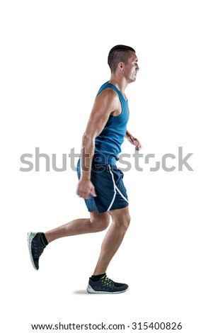Full length of man in sportswear jogging against white background - stock photo