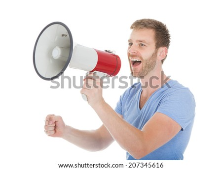 Full length of man screaming into megaphone over white background - stock photo