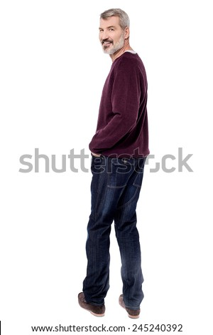 Full  length of mature man looking over his shoulder