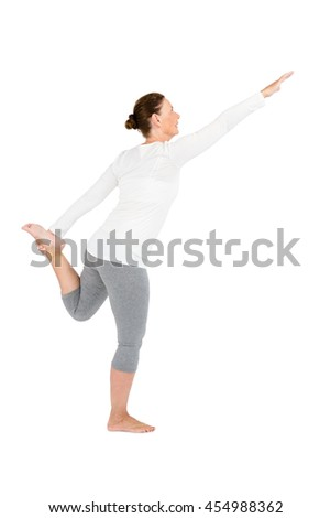 Full length of mature woman exercising on while background