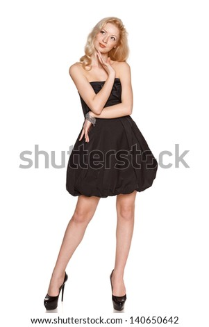 Full length of pensive woman wearing black cocktail dress looking up, isolated on white background - stock photo