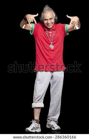 Full length of senior man gesturing with both the hands - stock photo
