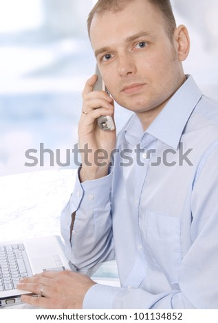 Full length of successful business man presenting over white background - stock photo