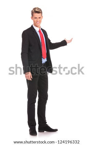Full length of successful business man presenting over white background