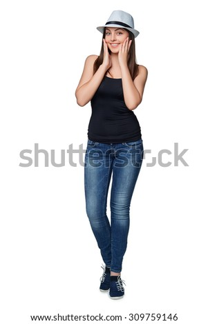 Full length of surprised young stylish slim female in hat holding her head in amazement and open-mouthed, isolated on white background. - stock photo