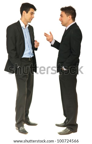 Full length of two business men having conversation together isolated on white background - stock photo