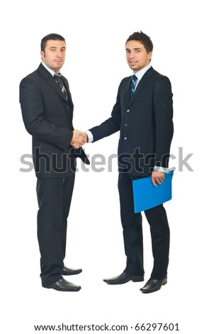 Full length of two business men shaking hands and one of them holding a folder with contract isolated on white background