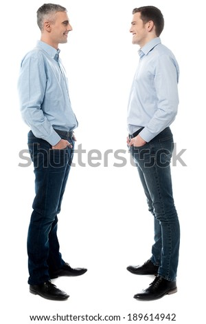 Full length of two executives standing on white background - stock photo