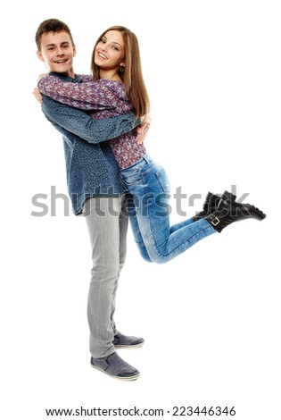 Full length of two happy teenagers isolated on white - stock photo