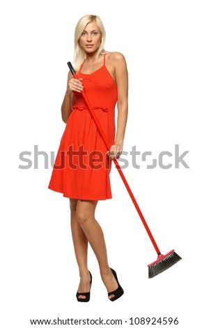 Full length of woman standing with broom, isolated on white background - stock photo