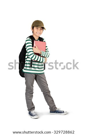 Full length of young asian boy standing and holding books, Isolated over white - stock photo