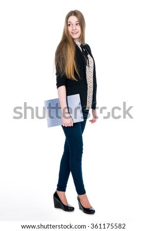 Full length of young blond smiling girl holding clipboard surprise looking back. Isolated on white background - stock photo