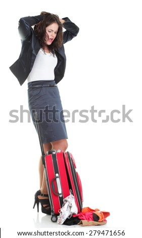 Full length of young business woman to late mishap misadventure pulling red travel bag isolated on white background