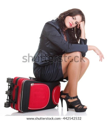Full length of young business woman to late pulling red travel bag clock isolated on white background